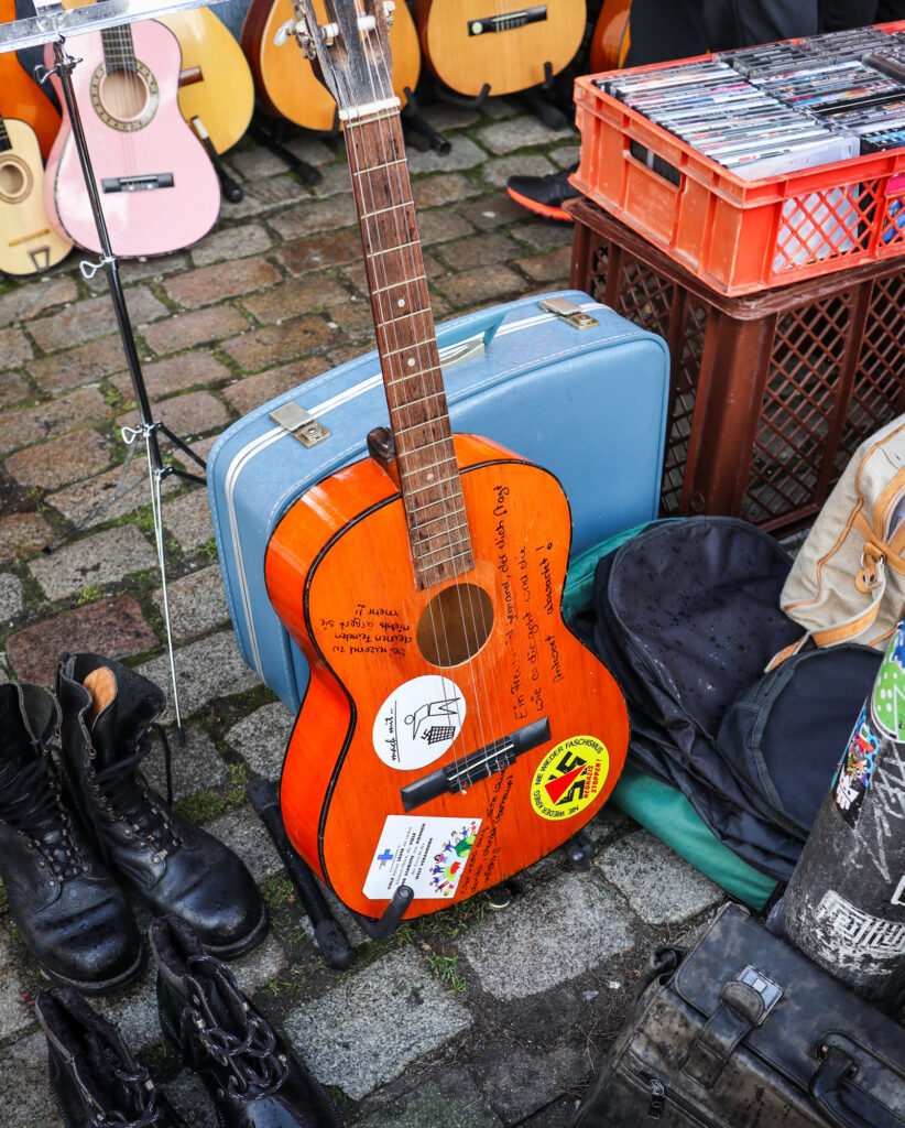 Guitars and suitcases for sale at the St Pauli flea market in Hamburg