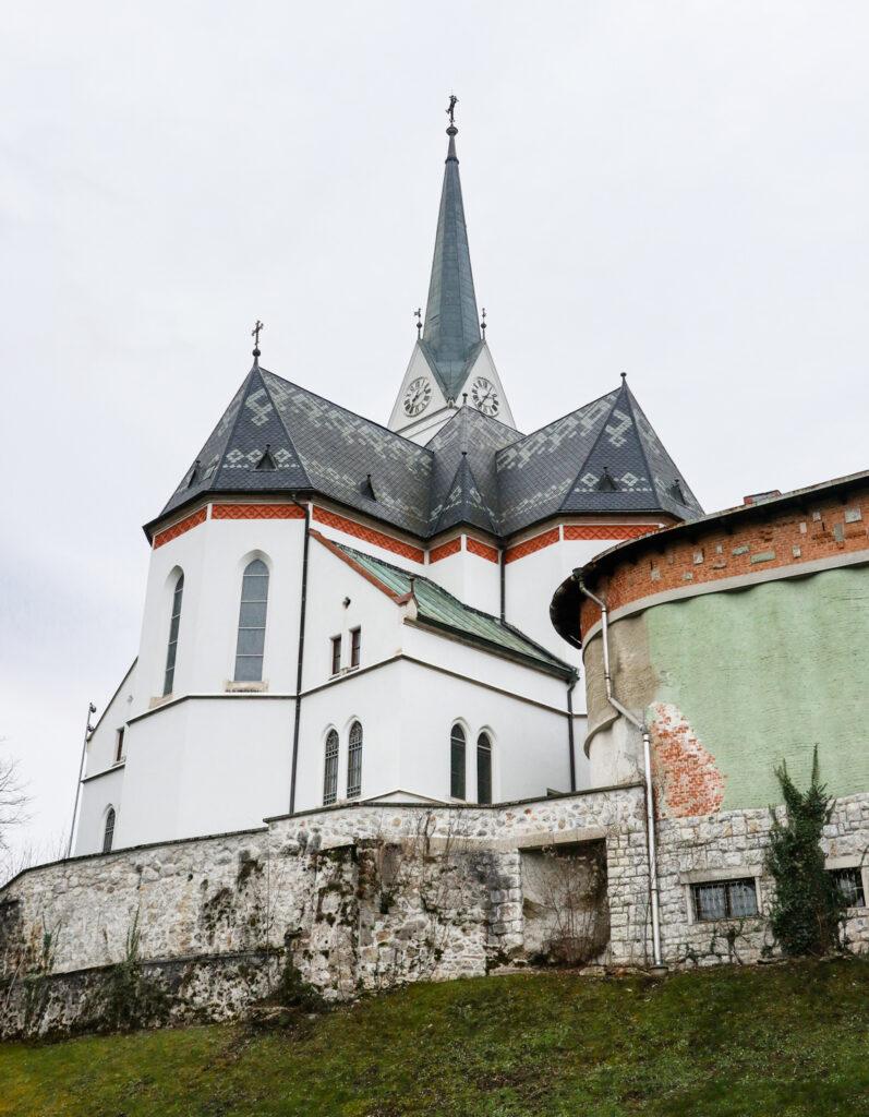 The white exterior of St. Martina Parish Church in Bled, Slovenia